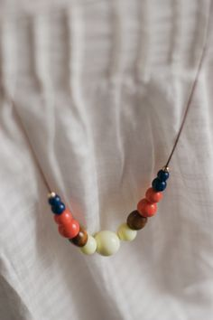 Adjustable beaded statement necklace (wear it long or short!) $33.00 / navy blue, gold, orange, wooden and white vintage beads
