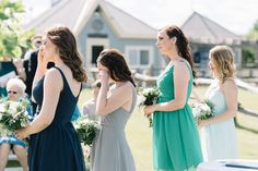 A mix of color and style is one of our favorite bridesmaid trends! Recreate this bridal party's short bridesmaid dress looks at David's Bridal | Tracey Jazmin Photography