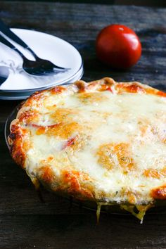 Recipe for Tomato Pie - I served this classic southern comfort with pork chops.   It's just pie heaven on a plate, and the perfect way to use up over ripe tomatoes.  It's messy and doesn't stay to form when you take it out of the pan, but tastes good!