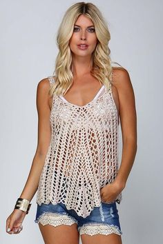 Wear this crochet tank with a bralette to add a pop of color. This fun boho style is great layered and also great with a necklace added! • Knit crochet tank top • See through knitting • Deep V-neck •