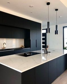a stylish minimalist black and white kitchen with a white marble kitchen island . - a stylish minimalist black and white kitchen with a white marble kitchen island … , - Luxury Kitchen Design, Contemporary Kitchen Design, Interior Design Kitchen, Kitchen Designs, Design Bathroom, Bathroom Ideas, Bathroom Things, Contemporary Houses, Toilet Design