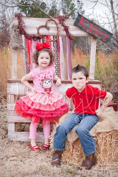 Rustic kissing booth with a vintage look, kids portraits by Candace Armstrong in Atlanta GA www.ForEveryLife.com Valentine's Day Portraits, pallet art, pink tutu, heart sucker, burlap, ribbon backdrop, bale of hay, tall grass