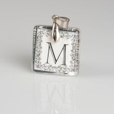 Hey, I found this really awesome Etsy listing at https://www.etsy.com/listing/93342422/letter-m-monogram-glass-tile-pendant
