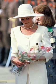Diana, Princess of Wales, holds bouquets of flowers at the airport during the first day of her official visit to Hungary on May 8, 1990 in Budapest, Hungary.
