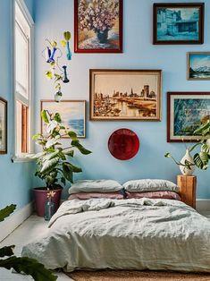 pale blue bedroom full of plants and vintage paintings #TileEffectLaminateFlooring Pale Blue Bedrooms, Blue Bedroom Walls, Blue Rooms, Pale Blue Walls, Bedroom Wall Designs, Home Decor Bedroom, Teen Bedroom, Bedroom Wall Colour Ideas, Bedroom Ideas