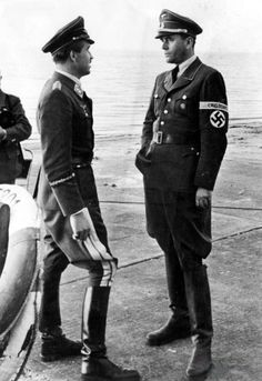 """Adolf """"Dolfo"""" Joseph Ferdinand Galland German Luftwaffe general March 1912 – 9 February 1996 on Left in the photo & on right Berthold Konrad Hermann Albert Speer March 1905 – September 1981 photo Colourised by Pearse Adolf Galland, Ww2 Uniforms, Military Uniforms, Ww2 History, History Pics, German People, Flying Ace, The Third Reich, Military Photos"""