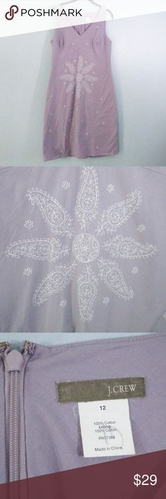 J. Crew Light Purple Embroidered Cotton Dress - 12 J. Crew Light Purple Embroidered Cotton Dress  Size 12 Sleeveless  This 100% cotton dress is in terrific condition. There is an initial on the tag.  It's fully lined in cotton fabric that is the same color.   It has a large embroidered flower on the front and the rest of the dress has tiny embroidered flowers.  Zip back with hook closure.  Pet friendly / smoke free home. J. Crew Dresses Midi