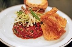 Steak tartare with waffle chips at The Saint on Ossington.