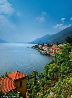 Houses line the shore of the shining Lake Maggiore...