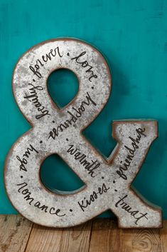 Use a metal ampersand to customize your displays