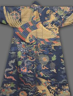 China, Qing Dynasty (1644-1911), Kangxi Period (1662-1722), 17th century, Tibetan Man's Robe, Chuba, satin weave with supplementary weft patterning; silk, gilt-metal thread and peacock-feathered thread, Overall: 162.60 x 191.80 cm, Cleveland Museum of Art