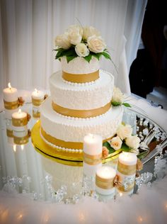 Exquisite wedding cake setup surrounded by Ivory Beeswax Candles