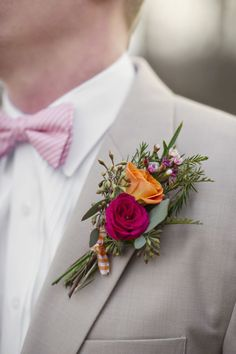 Love with Bright Juicy Pops of Color Love the contrast of the bright orange & fuschia Groom's boutonniere against the khaki suit.Love the contrast of the bright orange & fuschia Groom's boutonniere against the khaki suit. Corsage And Boutonniere, Groom Boutonniere, Boutonnieres, Orange Boutonniere, Fall Wedding, Our Wedding, Dream Wedding, Wedding Beauty, Wedding Makeup