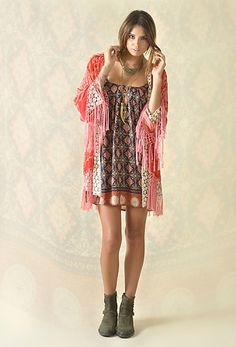 I love this! Little Moroccan dress paired with a pretty fringed kimono and boots. Feminine boho fall outfit.