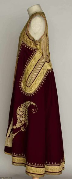 REGIONAL WOMAN'S COAT, ALBANIA, c. 1900 Marroon wool felt w/ metallic gold embroidery & gilt ribbon trim, sleeveless, narrow back, open front