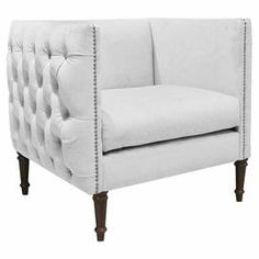 """LOVE! Diamond-tufted and nailhead-trimmed club chair with a pine wood frame and foam cushioning. Handmade in the USA.  Product: ChairConstruction Material: Solid pine frame and polyurethane and polyester fillColor: Velvet whiteFeatures: Handmade in the USADimensions: 33"""" H x 33"""" W x 28"""" DNote: Assembly requiredCleaning and Care: Spot clean only"""