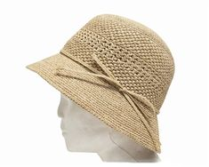 A tight weave natural raffia crochet kettle hat like these large straw beach…