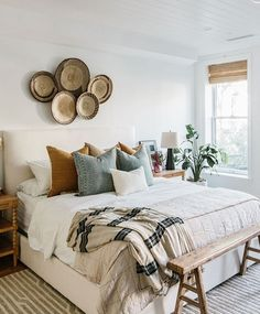 """May 3, 2020 - """"Natural accents like these woven baskets and rustic bench make this #MyParachuteHome a polished, yet boho oasis."""" Room Ideas Bedroom, Home Decor Bedroom, Tan Bedroom, Earthy Bedroom, Modern Boho Master Bedroom, Nature Bedroom, Vintage Bedroom Decor, Bed Room, Bright Bedroom Ideas"""