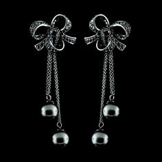 18K Black Bow Earrings with Black Diamonds and Tahitian Pearls.