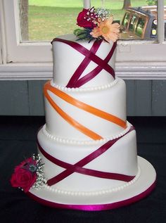 Fuchsia and tangerine ribbon wedding cake. Change the fuchsia to teal! Perfect size even!