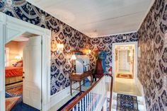 The second floor foyer at #WinterwoodatPetersham, with painted wide pine floors. There are two half-baths on the right side of the hall. #Bedandbreakfastforsale http://www.19northmainstreet.com
