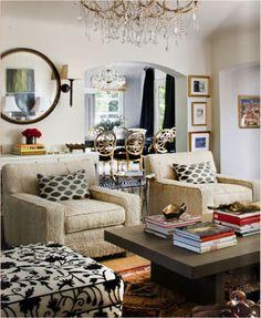 Tia Zoldan- chairs, coffee table, tribal rug layered over sisal