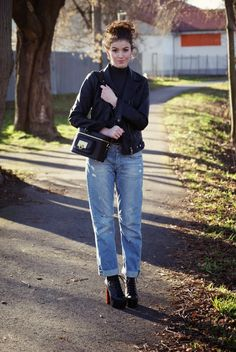 Shop this look for $172: http://lookastic.com/women/looks/boyfriend-jeans-and-jacket-and-turtleneck-and-boots-and-crossbody-bag/1945 — Blue Boyfriend Jeans — Black Leather Jacket — Charcoal Turtleneck — Black Leather Boots — Black Leather Crossbody Bag