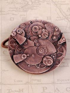 "Our signature Steampunk belt buckle is cast from the detailed movements of a clock. This buckle can also be purchased on our 1 3/4"" Steampunk Belt. Measures 2 1/4"" (5.7 cm) in diameter. Available in b"
