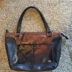 SAK Pocketbook Very nice, hardly used (maybe 5 times) SAK satchel. Dark brown & rust color leather with bronze shimmer on the front section. Very spacious inside with one zip pocket & 2 accessories pockets. Large zipper pocket on front & slot for your cell phone on the back. The Sak Bags Shoulder Bags