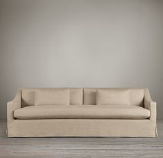 The lines are perfect. RH Belgian Classic Slope Arm Slipcovered Sofa.