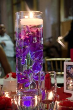 "Campbell Wedding (1): Tamara also created their floral centerpieces for the reception after a local florist wanted $100 each.  ""I hate flowers,"" she says. ""I'm so not the girly girl.""  Tamara and Kai experimented with flowers they could buy a day ahead that would still look fresh on their wedding day.  They settled on orchids submerged in long glass vases from a wholesaler for under $20 each."