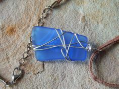 wire wrapped recycled glass pendant. Recycled Blue Wire Wrapped Glass Pendant By UniqueChiqueJewelry Y