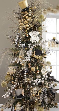 Festive Black/Gold/Silver Tree.   I love love the bigger size gold & silver ornaments, the gold curly bows, the gold & black ribbon, the clocks & other festive ornaments.