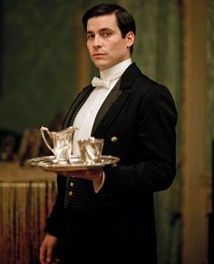 """Rob James Collier on set as Thomas Barrow, in the drama series """"Downton Abbey"""" written and created by Oscar-winning writer Julian Fellowes Downton Abbey Saison 4, Downton Abbey Thomas, Downton Abbey Episodes, Rob James Collier, English Country Manor, Laura Carmichael, Shirley Maclaine, Michelle Dockery, Working Class"""