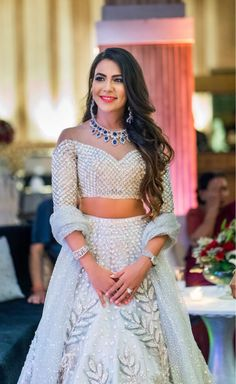 Gorgeous white shimmery lehenga for sangeet. See more on wedmegood.com #wedmegood #indianwedding #indianbride #lehenga #lehengacholi #sangeet #outfits #jewellery