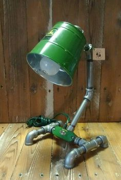 #14 ... John Deere industrial pipe lamp, toggle switch on/off. Truly a unique lighting solution with many applications. As each lamp is handcrafted and unique they are subject to minute variations from the picture above. Simple, bold and genuine this is a great desk lamp which is sure to leave an impression.  Industrial Lighting Decor DIY Project Ideas MaritimeVintage.com