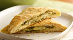 Bake these delicious pesto, chicken and cheese sandwiches using Pillsbury� crescent dinner rolls � a tasty dinner.