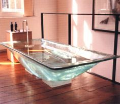 If wood is a bit too dark, maybe a glass bath sitting on a lit plinth? for-the-home