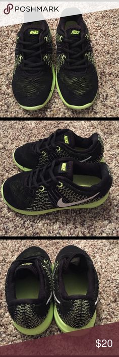 Toddler's Nike Sneakers! Look practically brand new! Just one tiny spot (in pictures) that was snagged on a small nail, but not noticeable at all! No wear on bottoms! Lace-up! Size 8c! Open to offers! Nike Shoes Sneakers