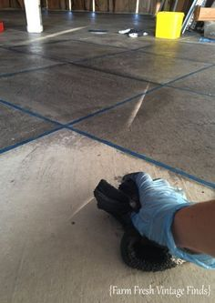 How I stained my concrete floor to look like tile, with a $9 gallon of oops concrete stain. farmfreshvintagefinds.com