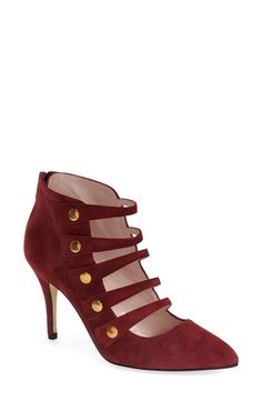 Laddered straps highlighted with gold studs modernize the look of this wine colored Kate Spade pump.