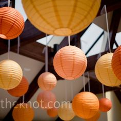Orange Paper Lantern Decor  The multihued paper lanterns that hung from the ceiling of the reception space were one of Laura's favorite aspects of her wedding -- there were 200 total!