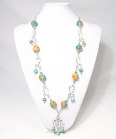 Dangling Clay Flower Necklace | AllFreeJewelryMaking.com