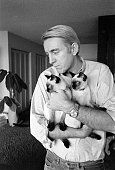 1967 Rod McKuen poses with a pair of Siamese Cats in his arms South Africa 2