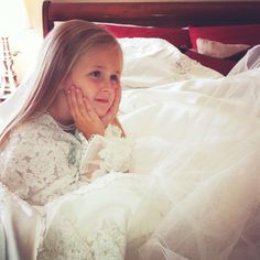 Take a picture of your daughter wearing YOUR wedding dress and display it on her wedding day! So sweet!