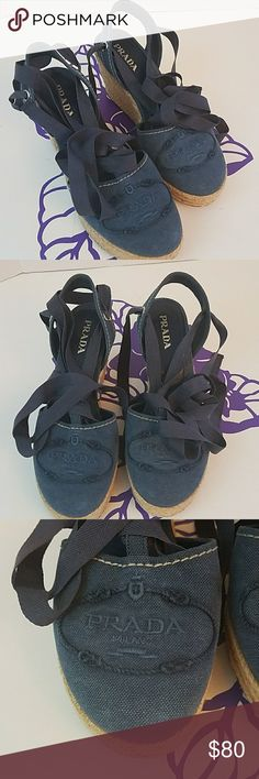 "Prada blue canvas wedges with ankle ties This product wedges are in beautiful condition. They feature a blue canvas with roped detail, 3 1/2"" wedge heel and Prada logo embroidered on front of shoe. These are authentic Prada. Prada Shoes Wedges"