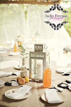 Peach themed tablescapes with peaches, steel candle lanterns, and mismatched vintage china on burlap covered table.  Summer shabby chic barn wedding. Photography by Andie Freeman Photography www.TheAthensWeddingPhotographer.com Event design, floral, and planning by Wildflower Event Services www.WildflowerEventServices.com Venue:  Private property in Chickamauga, Ga Candle Lanterns, Candles, Barn Wedding Inspiration, Centerpieces, Table Decorations, Event Services, Private Property, Vintage China, Peaches