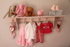 I want to do something like this in my office with the vintage baby clothes that I have from my childhood and the ones I have picked up for the boys.
