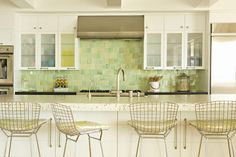 Great backsplash colors and tile size, love the chairs, always like white in a kitchen.  I want it all.