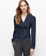 Petite Silk Tie Neck Blouse - A quintessential staple in the season's prettiest colors, this luxurious silk blouse is detailed with a tie neck for sophisticated allure. V-neck with ties. Long sleeves with button closure. Button front. Shirred forward shoulder seams. Shirred back yoke. Shirttail hem.